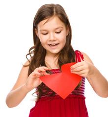 Portrait of a happy little girl in red