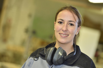 Young woman in workshop attending training course