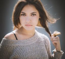 Portrait of a beautiful brunette. Close-up. Color toned.