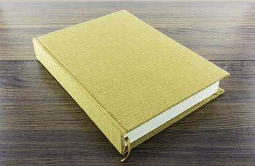 brown notebook on wood