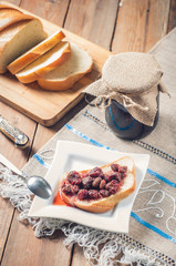 Strawberry Jam, bread on the table background