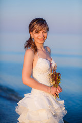 beautiful bride on the sea