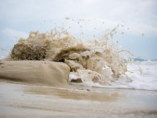 Waves crashing on the sand
