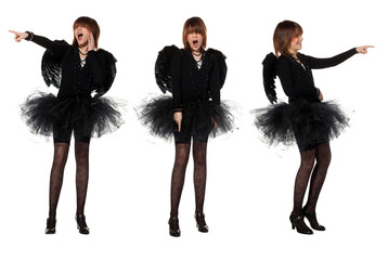 Teenage girl in costume of black angel