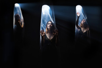 agoraphobia 3 girls woman inside a plastic bag,  bright light