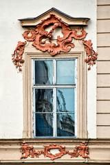 Window with pediment in Prague, Czech Republic