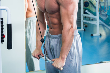 Working out with weights.Man makes exercises