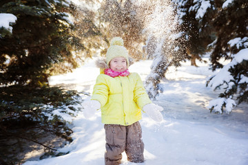 portrait of a little girl in a snowy forest