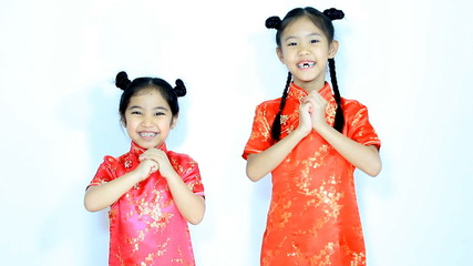 Happy little Asian Chinese children in traditional dress