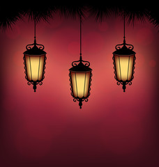 Three illuminated lanterns with pine branches on red background