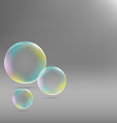 Three transparent soap bubbles with shadows on grayscale backgro