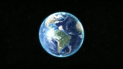 Realistic Earth rotating over space background