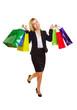 Lachende Frau mit vielen Einkaufstüten