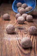 Chocolate truffles with cocoa, nuts, dried fruit, figs and honey