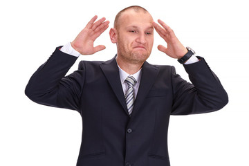 Discouraged, unshaved businessman in a dark suit, raising his ha
