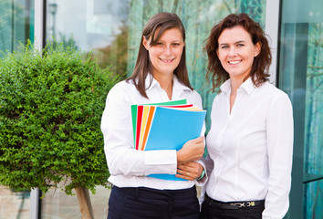 female students with notebook