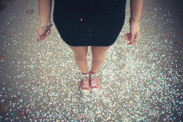 close up of legs women and confetti