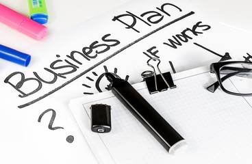 business plan words near highlighters and glasses