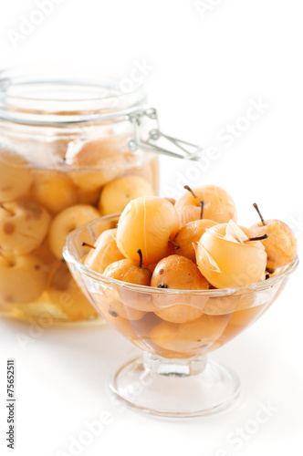 Apple compote in a glass vase and jar on white background