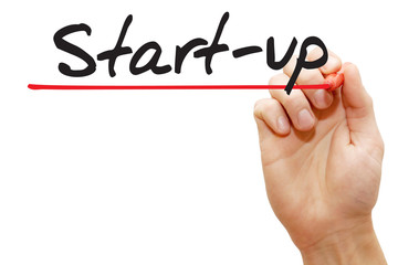Hand writing Start-up with red marker, business concept