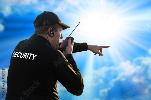 back of a security guard - 75654381