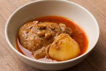 Close up Muslim style chicken and potato curry or chicken mussam