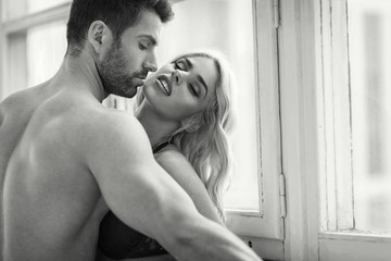 Black and white portrait of sensual couple