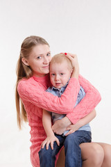 Young mother calms her son