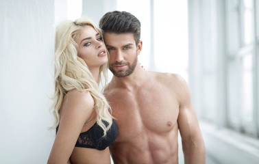 Sexy blond woman and handsome man