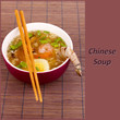 Chinese soup in bowl on bamboo mat and sample text