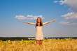 Happy young girl in field