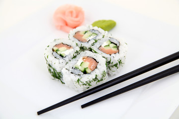 Uramaki with salmon.  Traditional japanese sushi rolls