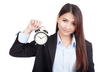 Young Asian businesswoman smile with alarm clock