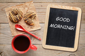 Coffee cup, cookies and blackboard with Good morning! phrase