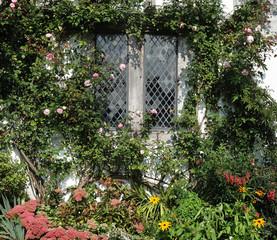 Summer flowers around a cottage window