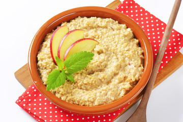 Oatmeal porridge with sliced apple