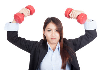 Young Asian businesswoman with red dumbbells