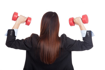 Back of young Asian businesswoman with red dumbbells