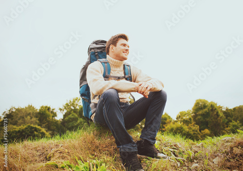 canvas print picture smiling man with backpack hiking