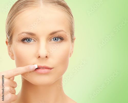 canvas print picture beautiful young woman pointing finger to her lips