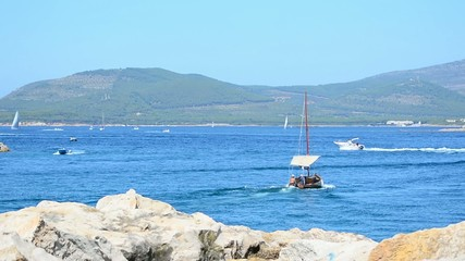 boats sailing in Alghero harbor, Italy