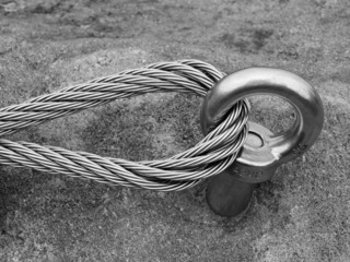 Climbers equipment. Iron twisted rope fixed in block by screws