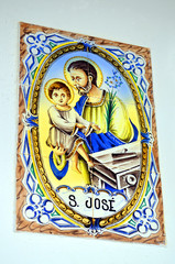 Tiles with a male with a child in Alte, Portugal