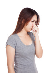Young Asian woman  holding her nose because of a bad smell