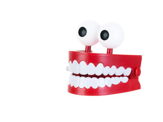 Chattering teeth on a white background