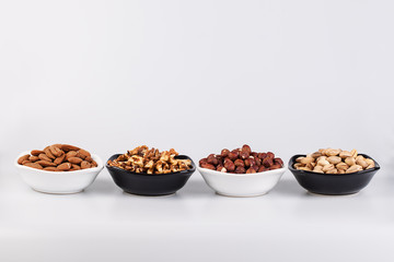Assorted nuts in ceramic bowls