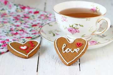 Tea and colorful heart cookies