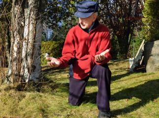 elderly feeding birds