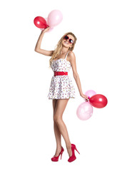Young beautiful woman with glasses holding red pink balloons, va