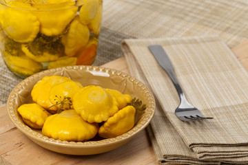 Pickled Yellow Pattypan Squash. Selective focus.